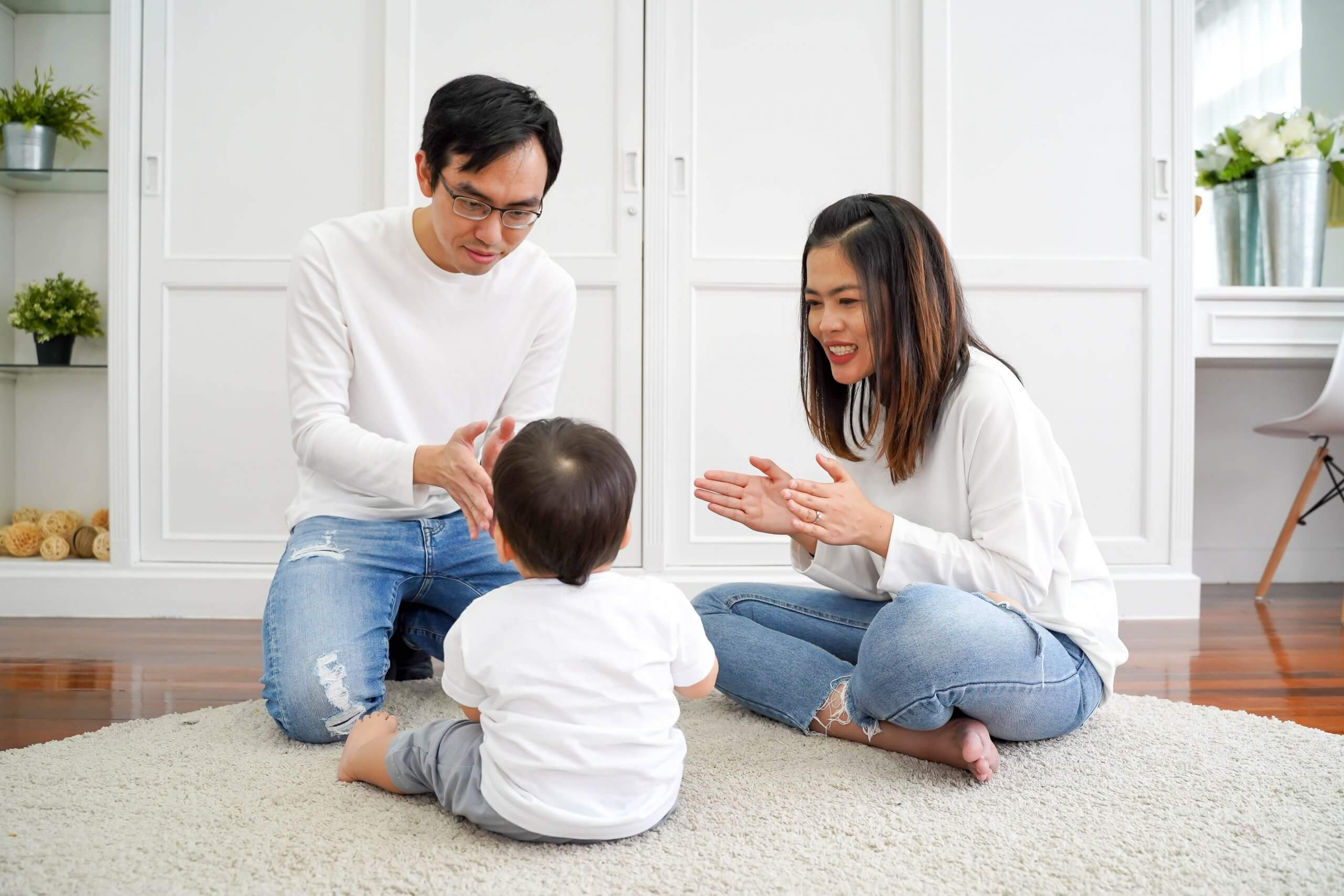 Happy Asian Family Of Three, Young Father And Mother Playing Gam - Autism  Spectrum Therapies